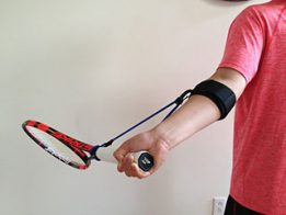 PermaWrist training aid lays back the wrist in a forehand