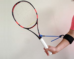 PermaWrist Training Aid Placing The Wrist In A Locked L-position With The Racket